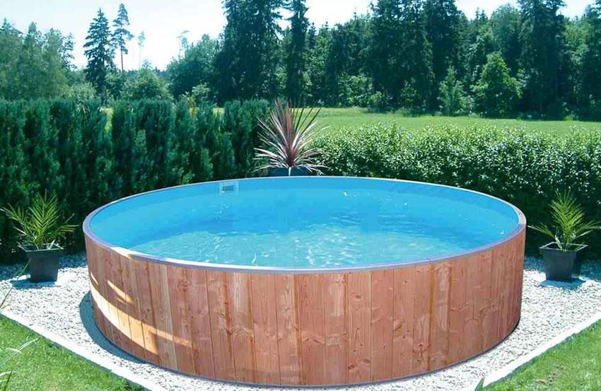 Piscine fuori terra rivestite in legno steel wood for Faretti per piscine fuori terra